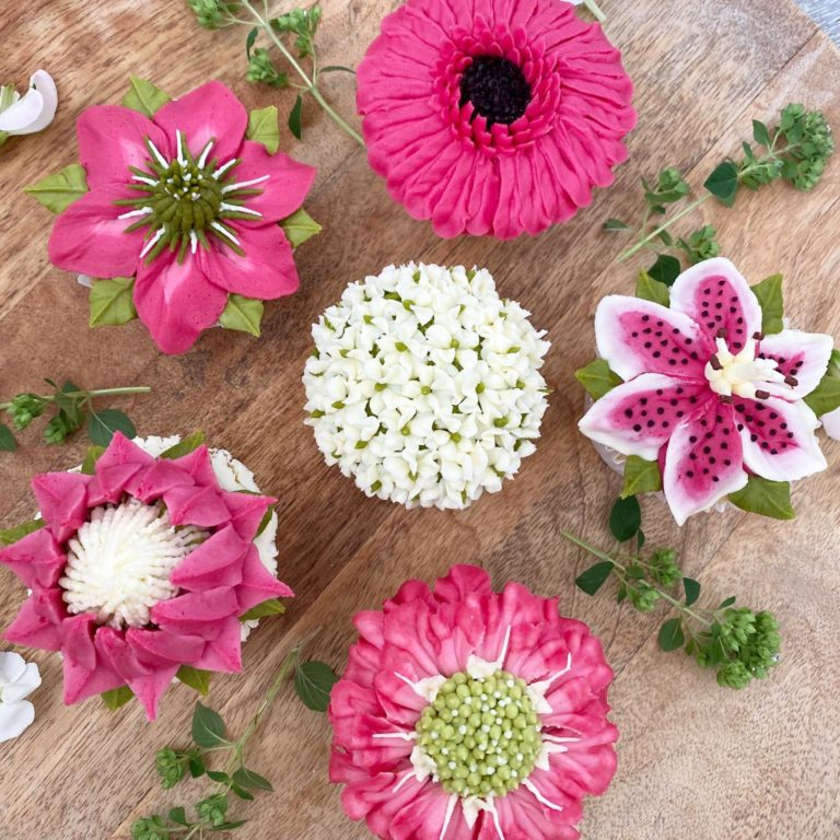 Learn how to pipe buttercream flower cupcakes.